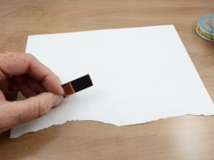 Flexible magnetic strip is protected by a red plastic backing